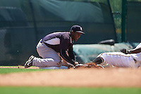 GCL Yankees East third baseman Yeison Corredera (87) fields a throw as Melvin Jimenez (right) slides into third during a game against the GCL Pirates on August 15, 2016 at the Pirate City in Bradenton, Florida.  GCL Pirates defeated GCL Yankees East 5-2.  (Mike Janes/Four Seam Images)