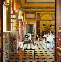The walls of the formal dining room have been painted to resemble marble