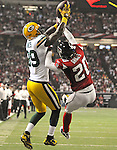 Green Bay Packers receiver James Jones out jumps Falcons corner Brent Grimes for a touchdown against the Atlanta Falcons during the second quarter of the Divisional round playoff game at the Georgia Dome in Atlanta, Ga., on Saturday, Jan. 15, 2011.
