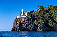 Lighthouse guiding ships into Portofino harbor.