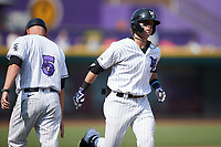 Travis Maniot (14) of the Winston-Salem Dash rounds the bases after hitting a home run against the Hickory Crawdads at Truist Stadium on July 10, 2021 in Winston-Salem, North Carolina. (Brian Westerholt/Four Seam Images)