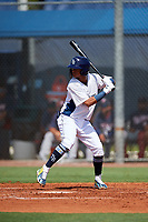GCL Rays shortstop Jelfry Marte (5) at bat during a game against the GCL Twins on August 9, 2018 at Charlotte Sports Park in Port Charlotte, Florida.  GCL Twins defeated GCL Rays 5-2.  (Mike Janes/Four Seam Images)