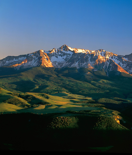 Sunrise and Wilson Peak in summer, Telluride, Colorado, USA John guides custom photo tours in the Sneffels Range and throughout Colorado. .  John leads private photo tours in Telluride and the San Juan Mountains. Year-round Colorado photo tours.