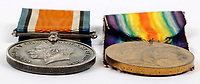 BNPS.co.uk (01202) 558833. <br /> Pic: C&TAuctioneers/BNPS<br /> <br /> Pictured from left: British War Medal and the British Victory Medal<br /> <br /> The medals of a Tommy who was killed at the Somme while dribbling a football across No Man's Land in the 'Great European Cup' have emerged for sale.<br /> <br /> Private John Buckle and his fellow members of the 8th Battalion East Surrey Regiment passed the balls to each other as they advanced on the German trenches.