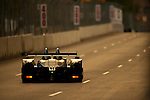during the Inaugural Baltimore Grand Prix in Baltimore, Maryland on September 2nd, 2011, the #52 American Le Mans PC Class car driven by Dobson/Lewis heads toward the setting sun on Baltimore's city streets during the waning minutes of qualifying. .