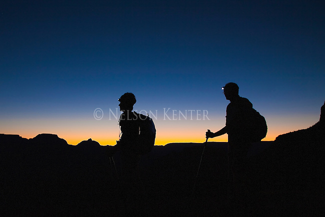 Two hikers getting an early start on a rim to rim hike across Grand Canyon