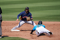 Houston Astros second baseman C.J. Hinojosa (60) waits for a throw as Lewis Brinson (25) slides in during a Major League Spring Training game against the Miami Marlins on March 21, 2021 at Roger Dean Stadium in Jupiter, Florida.  (Mike Janes/Four Seam Images)