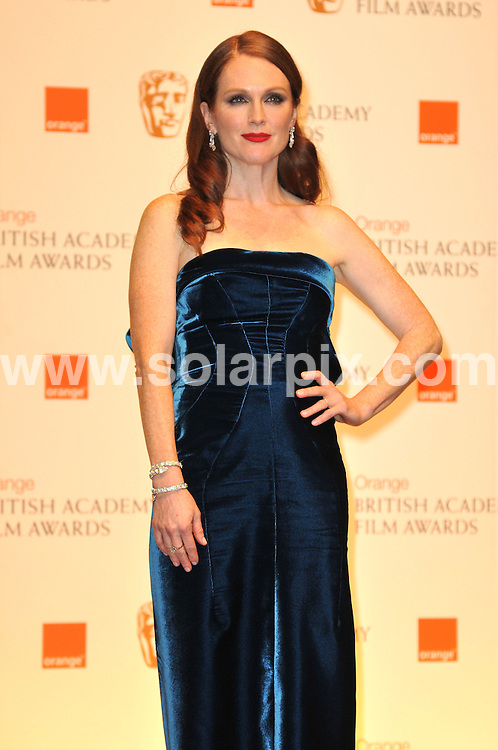 **ALL ROUND PICTURES FROM SOLARPIX.COM**                                             **WORLDWIDE SYNDICATION RIGHTS**                                                                                  Arrivals to the Orange British Academy Film Awards held at The Royal Opera House, London, UK. February 13, 2011                                                                            .This pic:  Julianne Moore                                                                             JOB REF:    12796    MSR       DATE:    13.02.11                                                        **MUST CREDIT SOLARPIX.COM OR DOUBLE FEE WILL BE CHARGED**                                                                      **MUST AGREE FEE BEFORE ONLINE USAGE**                               **CALL US ON: +34 952 811 768 or LOW RATE FROM UK 0844 617 7637**