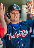 31 May 2018: New Hampshire Fisher Cats designated hitter Aledmys Diaz returns to the dugout after scoring in the first inning against the Portland Sea Dogs at Northeast Delta Dental Stadium in Manchester, NH. The Sea Dogs defeated the Fisher Cats 12-9 in extra innings. Mandatory Credit: Ed Wolfstein Photo *** RAW (NEF) Image File Available ***