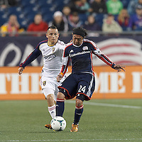 New England Revolution midfielder Lee Nguyen (24) passes the ball as Real Salt Lake midfielder Luis Gil (21) closes. In a Major League Soccer (MLS) match, Real Salt Lake (white)defeated the New England Revolution (blue), 2-1, at Gillette Stadium on May 8, 2013.