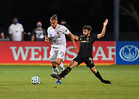 LAKE BUENA VISTA, FL - JULY 18: Rolf Feltscher #25 of LA Galaxy turns away from Diego Rossi #9 of LAFC during a game between Los Angeles Galaxy and Los Angeles FC at ESPN Wide World of Sports on July 18, 2020 in Lake Buena Vista, Florida.