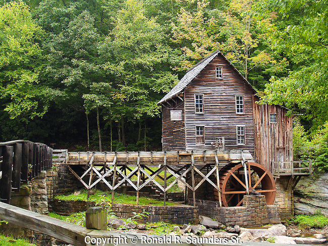 The Glade Creek Grist Mill is a new mill that was completed in 1976 at Babcock. Fully operable, this mill was built as a <br /> re-creation of one which once ground grain on Glade Creek long before Babcock became a state park. Known as Cooper's Mill, it stood on the present location of the park's administration building.<br /> (6)