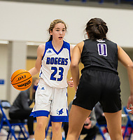 Ava Maner (23) of Rogers dribbling ball, as Ariana Saitta (0) of Fayetteville defends at King Arena, Rogers, AR January 8, 2021 / Special to NWA Democrat-Gazette/ David Beach
