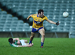 Alan Sweeney of Clare  in action against Cormac Flanagan of Limerick during the Mc Nulty Cup U-21 final at The Gaelic Grounds. Photograph by John Kelly.