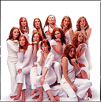 Group of red haired women wearing white clothes blowing kisses<br />