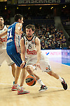 Real Madrid´s Sergio Llull and Anadolu Efes´s Milko Bjelica during 2014-15 Euroleague Basketball match between Real Madrid and Anadolu Efes at Palacio de los Deportes stadium in Madrid, Spain. December 18, 2014. (ALTERPHOTOS/Luis Fernandez)
