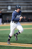 Nick Collins (33) of the Georgetown Hoyas hustles down the first base line against the VCU Rams at Wake Forest Baseball Park on February 13, 2015 in Winston-Salem, North Carolina.  The Rams defeated the Hoyas 6-3.  (Brian Westerholt/Four Seam Images)