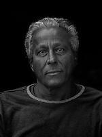 Portrait made using ultraviolet light of VII photographer Ed Kashi.