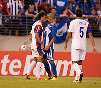 Alexander Lopez (16) of Honduras argues with Michael Barrantes (11) of Costa Rica during the quarterfinals of the CONCACAF Gold Cup at M&T Bank Stadium in Baltimore, MD.  Honduras defeated Costa Rica, 1-0.