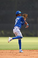FCL Blue Jays shortstop Rikelin De Castro (27) throws to first base during a game against the FCL Yankees on June 29, 2021 at the Yankees Minor League Complex in Tampa, Florida.  (Mike Janes/Four Seam Images)