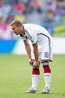 Lukas Podolski of Germany pulls his socks up