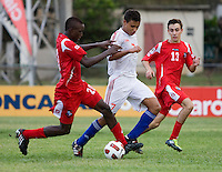 Kianz Froese (7) of Cuba is tackled by Alexander Gonzalez (20) of Panama during the group stage of the CONCACAF Men's Under 17 Championship at Jarrett Park in Montego Bay, Jamaica. Panama tied Cuba, 0-0.