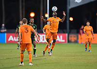 LAKE BUENA VISTA, FL - JULY 18: Maynor Figueroa #15 of the Houston Dynamo flicks the ball with his head during a game between Houston Dynamo and Portland Timbers at ESPN Wide World of Sports on July 18, 2020 in Lake Buena Vista, Florida.