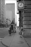 Montreal (Qc) CANADA - May 1984- a woman walk toward a newspaper kiosk in downtown Montreal