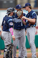 Corpus Christi Hooks pitcher Josh Hader (17) talks with catcher Tyler Heinemann (4) and shortstop Carlos Correa (1) during the Texas League baseball game against the San Antonio Missions on May 10, 2015 at Nelson Wolff Stadium in San Antonio, Texas. The Missions defeated the Hooks 6-5. (Andrew Woolley/Four Seam Images)