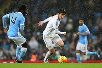Wilfried Bony and Ki Sung-Yueng during the Barclays Premier League Match between Manchester City and Swansea City played at the Etihad Stadium, Manchester on 12th December 2015