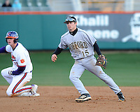 Shortstop Alec Paradowski (15) of the Wofford Terriers turns an inning-ending double play in the seventh inning of a game against the Clemson Tigers on Wednesday, March 6, 2013, at Doug Kingsmore Stadium in Clemson, South Carolina. Clemson won, 9-2. (Tom Priddy/Four Seam Images)