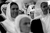 Women are waiting to see the bride Fatme during the celebration of the wedding ceremony in the village of Ribnovo, some 200 km from Sofia, Bulgaria.