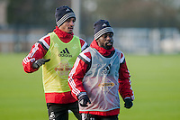 SWANSEA, WALES - JANUARY 28: Kyle Naughton and Nathan Dyer of Swansea City wait for the ball during training  on January 28, 2015 in Swansea, Wales.