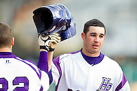 Josh Spano (21) of the High Point Panthers knocks helmets with teammate Dominic Fazio (32) after hitting a solo home run against the Ohio Bobcats at Willard Stadium on March 6, 2013 in High Point, North Carolina.  The Panthers defeated the Bobcats 4-1.  (Brian Westerholt/Four Seam Images)