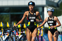 24 JUL 2014 - GLASGOW, GBR - Fabienne St. Louis (MRI) (left) from Mauritius and her team mate Emilie Ng Foong Po (MRI) race through transition for the start of the bike during the elite women's 2014 Commonwealth Games triathlon in Strathclyde Country Park, in Glasgow, Scotland (PHOTO COPYRIGHT © 2014 NIGEL FARROW, ALL RIGHTS RESERVED)<br /> *******************************<br /> COMMONWEALTH GAMES <br /> FEDERATION USAGE <br /> RULES APPLY<br /> *******************************