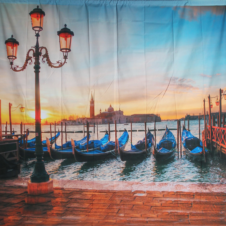 Backdrop featuring Venice canal gondola boats and water at sunset in the famous Italian city