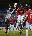 Deveronvale goalkeeper Darren McConnachie flaps at the ball as Raith's Brian Graham heads home Rovers' first ...