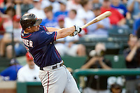 Minnesota Twins first baseman Michael Cuddyer #5 follows through on his fourth inning solo home run during a Major League Baseball game against the Texas Rangers at the Rangers Ballpark in Arlington, Texas on July 27, 2011. Minnesota defeated Texas 7-2.  (Andrew Woolley/Four Seam Images)