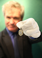 BNPS.co.uk (01202 558833)<br /> Pic: DeepSouthMedia/BNPS<br /> <br /> Pictured: Antique expert Martyn Downer with the silver pocket watch.<br /> <br /> A silver pocket watch that belonged to Lord Protector Oliver Cromwell has been unearthed after 369 years.<br /> <br /> The republican had the small timepiece on him in 1650 during his New Model Army's campaign in Ireland.<br /> <br /> Cromwell, who defeated King Charles I in the English Civil War, gave the watch to John Blackwell, deputy treasurer-at-war and an officer in the cavalry during the Siege of Cronmel in Ireland.<br /> <br /> It remained in the Blackwell family until it was sold to antique expert Martyn Downer who paid a not inconsiderable £18,000 for it.