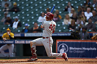 Brady Lindsly (40) of the Oklahoma Sooners follows through on his swing against the Missouri Tigers in game four of the 2020 Shriners Hospitals for Children College Classic at Minute Maid Park on February 29, 2020 in Houston, Texas. The Tigers defeated the Sooners 8-7. (Brian Westerholt/Four Seam Images)