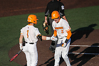 Tennessee Volunteers second baseman Max Ferguson (2) celebrates with Drew Gilbert (1) after scoring a run against the Arkansas Razorbacks on May 14, 2021, on Robert M. Lindsay Field at Lindsey Nelson Stadium in Knoxville, Tennessee. (Danny Parker/Four Seam Images)