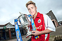 Stirling Albion player Sandy Cunningham gets a hold of the William Hill Scottish Cup prior to their second round match against Whitehill Welfare.