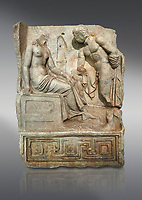 "Roman Sebasteion relief  sculpture of Io and Argos Aphrodisias Museum, Aphrodisias, Turkey. <br /> <br /> A powerful hero is folding a sword gazing closely at a half naked and dishevelled young heroine who sits on a chest like stool. Between, on a pillar base stood a small, separately added statue of a goddess ( now missing). The scene follows a scheme used in the relief panels ""Io guarded by Argos"". Io was one of Zeus's lovers, and Argos was a watchful giant sent to guard her by Hera, Zeus's wife."