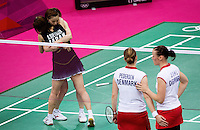 28 JUL 2012 - LONDON, GBR - Maeda Miyuki (JPN) (second from left) and Suetsuna Satoko (JPN) (left with back to camera) of Japan celebrate winning their London 2012 Olympic Games women's doubles group badminton match against Christinna Pedersen and Kamilla Rytrer Juhl of Denmark at Wembley Arena, London, Great Britain (PHOTO (C) 2012 NIGEL FARROW)