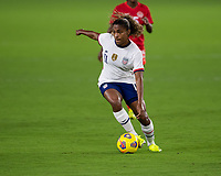 ORLANDO CITY, FL - FEBRUARY 18: Catarina Macario #11 dribbles away pressure during a game between Canada and USWNT at Exploria stadium on February 18, 2021 in Orlando City, Florida.