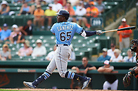 Tampa Bay Rays right fielder Jesus Sanchez (65) follows through on a swing during a Grapefruit League Spring Training game against the Baltimore Orioles on March 1, 2019 at Ed Smith Stadium in Sarasota, Florida.  Rays defeated the Orioles 10-5.  (Mike Janes/Four Seam Images)