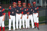 Batavia Muckdogs Jose Diaz (41), Victor Delgado (27), Pablo Garcia (7), Samuel Castro (25), and Isaiah White (18) during an autograph signing before a game against the West Virginia Black Bears on August 20, 2016 at Dwyer Stadium in Batavia, New York.  Batavia defeated West Virginia 7-2. (Mike Janes/Four Seam Images)