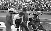 Fans watch the Daytona 500, Daytona International Speedway, Daytona Beach, FL, February 15, 1981.  (Photo by Brian Cleary/www.bcpix.com)