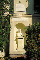 Bust of Henri Becquerel on pedestal in niche in external wall of Maison du Cuvier; plaque commemorates his discovery of radioactivity. Paris, France.