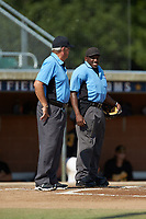 (L-R) Umpires Tommy Caudle and Marcus Neal prepare to work the game between the Statesville Owls and the High Point-Thomasville HiToms at Finch Field on July 19, 2020 in Thomasville, NC. The HiToms defeated the Owls 21-0. (Brian Westerholt/Four Seam Images)